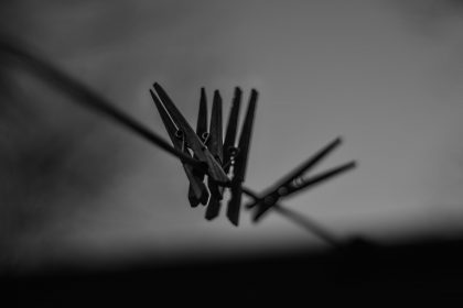Clothespins on line in black and white