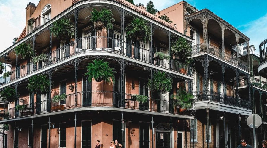 New Orleans historical architecture. Wrought iron balconies and ferns.