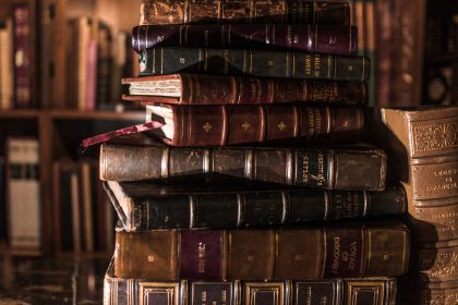 Stack of antique, leather-bound books.